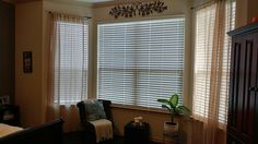 Curtains added to frame bay window.