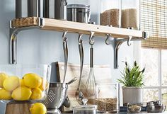 Two levels of storage out of one shelf. Storage for jars above, moveable hooks for utensils below. Loft Kitchen, Kitchen Cart, Kitchen Storage, Kitchen Ideas, Canister Sets, Diy Storage, Joss And Main, Knife Block, Kitchen Gadgets