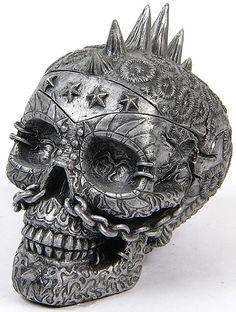 Metal skull. Skull is creepy but I like the detail in it maybe on something else.