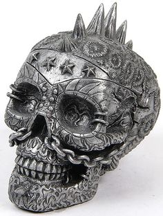 Metal skull. Skull is creepy but I like the detail in it maybe on something else.