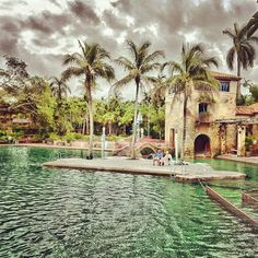 Venetian pool in Coral Gables, Florida.....a public swimming pool with palm trees!