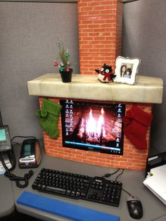 Recycled boxes and prints of brick is all that was used to turn this dull gray office into a festive one!  Love it!