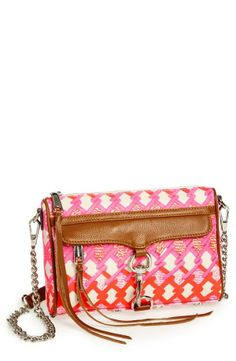 Cute little pink and orange crossbody for spring. Love the geo print on this Rebecca Minkoff creation.