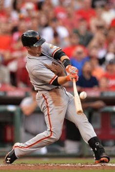 CINCINNATI, OH - JUNE 4: Buster Posey #28 of the San Francisco Giants flies out to end the top of the third inning against the Cincinnati Reds at Great American Ball Park on June 4, 2014 in Cincinnati, Ohio. (Photo by Jamie Sabau/Getty Images)