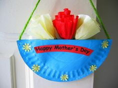 "Mother's Day Hanging Paper Plate Craft - ""This craft is easy enough for a child to make, and all it takes is a paper plate, some tissue paper, a bit of yarn and a dash of creativity! The yarn let's mom hang it anywhere she wants so the whole world can see just how much her children love her."""
