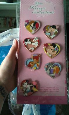 Kisses Collection (Limited Edition, 2011), set of six plus a Mickey/Minnie completer pin to make it a set of eight pins.