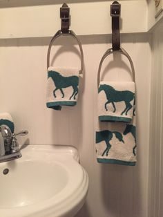 I made these towel holders from old stirrup irons and leathers that my daughters rode in.
