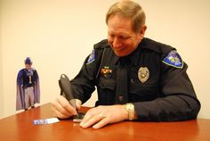 Flat Blue Devil visits with Duke Police for free property engraving