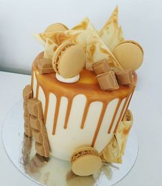 Caramilk Themed drizzle cake, with caramilk drizzle, white chocolate caramilk shards, and salted caramel macarons.