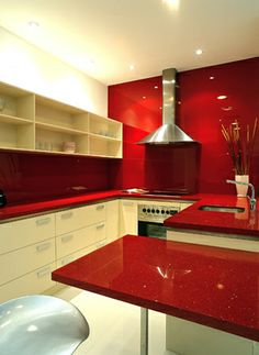 Caesarstone Classico 3452 Red Shimmer: http://www.caesarstone.com/en/The-Catalog/Pages/3452%20Red%20Shimmer.aspx