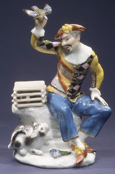 Johann Friedrich Eberlein (1695–1749) - Harlequin with Bird and Cat - Meissen Manufactory (German, 1710–present), ca. 1743 - Hard-paste porcelain - The Metropolitan Museum of Art, NY