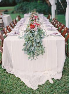Photography: The Great Romance Photo   thegreatromancephoto.com Floral Design: Passion Roots   www.passionroots.com/ Wedding Venue: Kualoa Ranch   kualoa.com   View more: http://stylemepretty.com/vault/gallery/27822