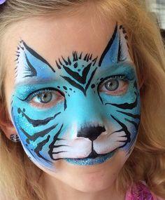 Blue tiger/cat face paint design.