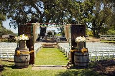 Vintage doors and wine barrels. Could be used as a ceremony alter or aisle entrance.