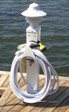 This heavy duty, rugged, non-metallic Mac Post™ is ideal when you need light, electric, and water in outdoor locations where it needs to be surface mounted, like this boat dock.  Need it to be buried in the ground? We have these too.  We build the Mac Posts for the locations you need and with  the options you want.  Call to see which will be the right solution for you.  561-723-0934.  www.MacCapLighting.com