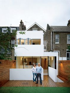"""Bruce Thatcher and Kirsty Leighton behind their """"Victorian on the outside"""" London home. Published in Dwell Magazine, Feb 10. Photo by: Matthew Williams   Read more: http://www.dwell.com/articles/composite-index.html"""