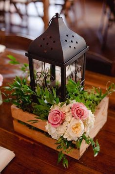 Lantern centerpiece on a farm table. Good idea to sit inside the wooden box.
