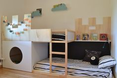 IKEA kura castle bunk bed. Castle aside, this is a really cool layout... good alternative to a mattress directly under the bed or across the room.