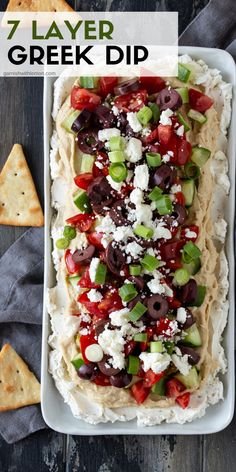 This Layered Greek Dip recipe (a spinoff of a dip) is an easy, make-ahead appetizer for a party. The briny Kalamata olives, juicy cucumbers, salty feta and garlicky hummus remind me of my favorite Greek salad. appetizers for a party Layered Greek Dip Greek Layer Dip, Greek Dip, Greek Salad, Greek Hummus Dip, Feta Dip, Seven Layer Dip, Fingerfood Recipes, Clean Eating Snacks, Healthy Snacks