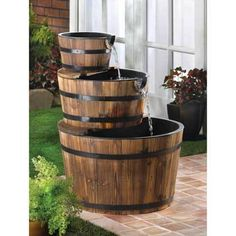 Apple Barrel Fountain: Sparkling waterfalls cascade from spout to spout down the faces of three stacked bushel baskets. This generously sized fountain with genuine wood trim adds bountiful rustic flair to your outdoor surroundings! Outdoor Gardens, Indoor Outdoor, Outdoor Living, Outdoor Decor, Rustic Outdoor, Water Barrel, Rain Barrel, Wine Barrel Water Feature, Whiskey Barrel Fountain