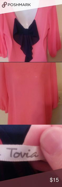 "Tovia Boutique Bow Back Short Coral Navy This is a sheer shirt in a coral color with a navy bow on back It is a size medium but the size tag was cut out. So follow measurements.  Measurements Chest 18"" laying flat 36 all around Length25"" Tovia Tops Blouses"