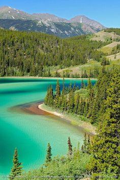 Emerald Lake ~ On the Klondike Highway is between Skagway, Alaska and Whitehorse, Yukon is the beautiful Emerald Lake.
