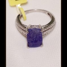 5.0 CTS RARE Tanzanite Rough Cut Ring 1 of the 10 rarest gemstones. Rough cut commands higher prices than faceted gems. NEW Genuine Rough Cut Tanzanite, Cushion Cut stone Ring in Platinum Overlay .925 Sterling Silver Nickel Free (Size 8) TGW 5.00 Cts. Tanzanite is said to be 1000 x more rare than a diamond. Only found at the base of Mt. Killamenjaro. It is rapidly nearing depletion as only 2 mines are now available and the are not finding quality gems. They have not been able to lab create…