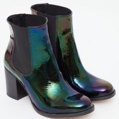 """NWOB TBA OIL SLICK BOOTIES NEW WITHOUT BOX. This black patent boot really is as amazing as it looks. Fully lined in leather. 4"""" total heel height with 1.5"""" platform. Rubber sole.   It should be noted that due to the leather, there are some creases in the boots, which is perfectly normal. Boots have only been tried on; they have never been worn.   SOLD OUT EVERYWHERE. Buy cheaper on our website thewildorchidshop.com Urban Outfitters Shoes Ankle Boots & Booties"""