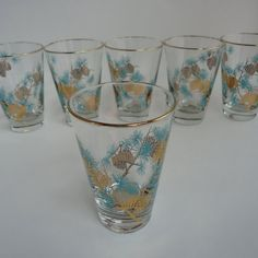 Mam-Maw also used these for her sweeeet iced tea on the rare occasions I remember her making it. She had a set of different sizes. I wonder if they were a prize from selling Stanley House Products. - Vintage Libbey Aqua and Gold Pine Cone Glass Tumblers, Set of 6 Drinking Glasses
