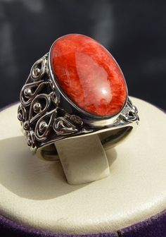 This ring is amazing. Part of our Anillo Moderno collection. The red Peruvian Coral is beautiful and the silver work is impressive. You will not be disappointed. We have incredibly high standards when it comes to the jewelry we sell and we want nothing more than for you to be pleased with your purchase. www.PeruvianAccent.com