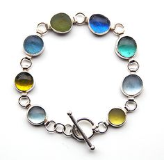 Recycled glass bracelet made with glass found on the banks of the Thames, London. Glass shards were re-formed in a kiln.