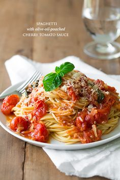 Olive oil poached cherry tomato sauce.