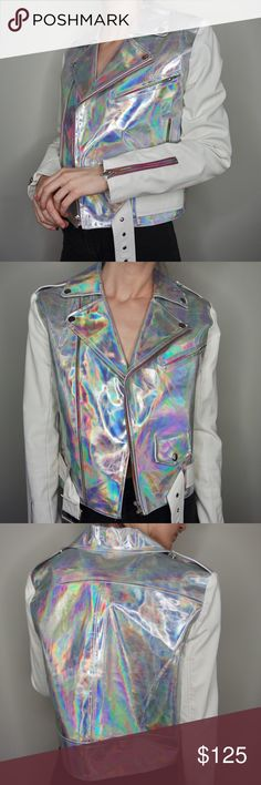 UNIF holographic Moto jacket UNIF holographic gammaray moto jacket with white faux leather sleeves and rainbow iridescent zippers. 3 functional pockets, two hand ones and a little button pouch in the front. Worn but still has a lot of life left. Adds character and a distressed grungey vibe! See last photo for close ups! Ultra rare!!!! Retails $178. Sold out. Size M. Can fit XS/S oversized or M More fitted. I am 5'6 32 bust 24 waist 32 hips. UNIF Jackets & Coats Utility Jackets