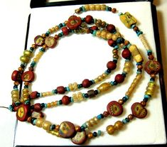 vintage roman bead necklace bc-ad face -bird 81.20 cts  $13500 http://www.jewelry-auctioned.com/auctions/vintage-roman-bead-necklace-bc-ad-face-bird-8120-cts-14543