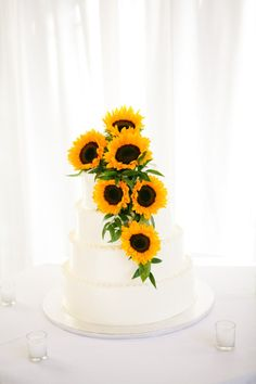 Closest thing i could find to what I'd want. White cake and sunflowers...a little less though