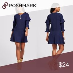 """Navy Ribbed Ruffle Sleeve Sweater Dress Keep your style sweet and cozy with the Ribbed Ruffle-Sleeve Sweater Dress from Eclair. Pair with a baseball cap and low-top sneakers for a sporty look or wear with a blanket scarf, tights and booties for dressed-up cold-weather style. No pocket, Elbow, Pullover, scoop neck, mini length.  Available online for full price.  Measurements: Suggested Size 4-6 35-36"""" bust 27-27.5"""" waist 37-38"""" hip  Materials: 95% Polyester 5% Spandex  No Trades Eclair…"""