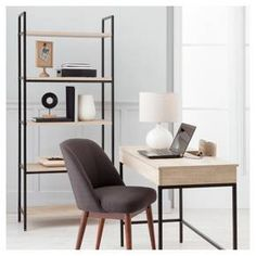 """• Metal construction<br>• Holds up to 30 pounds<br>• 5 wood-finished shelves<br>• 72x30.5x13.5""""<br>• Assembly required<br><br>With clean lines and plenty of shelf space, the Threshold Darley Bookcase in Vintage Oak is an elegant storage solution for a modern home. The understated metal frame contrasts with the wood-finish bookshelves to create a rustic feel. It's vertical space with minimalist style."""