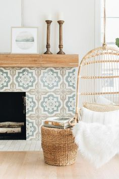 A tan and blue Moroccan style tiled fireplace boasts a rustic wood mantel and is. - A tan and blue Moroccan style tiled fireplace boasts a rustic wood mantel and is positioned behind - Southern Living, Hygge, Wood Mantels, Oak Mantel, Built In Seating, Piece A Vivre, Style Tile, Interiores Design, Decor Interior Design