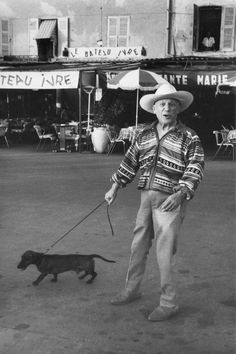 Pablo Picasso taking a walk with his dog on the French Riviera