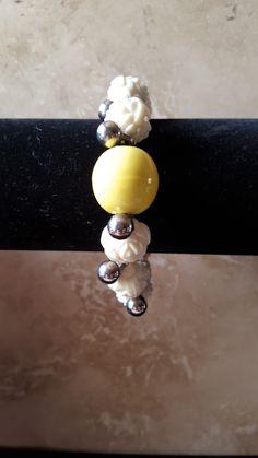 White rose and yellow beaded bracelet