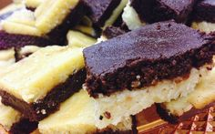 A rich burfi or fudge with a bitter sweet chocolate layer, that balances this amazing mithai, can be enjoyed anytime or on extra special occasions! Ing: 6 cu...