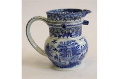 A YORKSHIRE PEARLWARE PUZZLE JUG, early 19th century, of baluster form with three spouts between