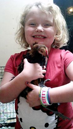 Honey Boo Boo, aka Alana Thompson, and her pet chicken, Nugget. She named the chicken Nugget. . . Isn't that, like, animal cruelty or something? She's basically telling the chicken what form she'll be eating it in once it dies.