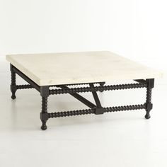 Spanish travertine top coffee table from Wisteria. $1199. Love this, so not affordable for me!