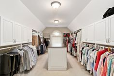 All the Bells & Whistles in this Master Closet: His & Her shoe shelves; Removable Hamper; Concealed Ironing Board; Slide-Out Dry Cleaning Basket; Full-Length Mirror; Retractable His & Her Valet Rods and Tie/Belt Racks; Jewelry Drawers with Organizers in the Island