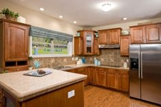 Kitchen in the Stonewall NS310A - Manorwood Two Story Modular Home. A great space for entertaining and family gatherings - this kitchen shows a drop in range, and a wall oven! Check out the options we offer on our website!
