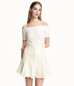 White off the shoulder top for Mom to wear. Could wear tucked into one of the skirts as shown or tucked into one of the pairs of pants.
