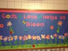 Christian spring bulletin board for preschool. Children did a shapes lesson while cutting and coloring the flower