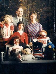 """I found this photo while going through old albums for my grandmother's viewing. The couple in the picture were friends of my grandparents.The woman made puppets and put on puppet shows for kids' birthdays. According to one family member,""""She wasn't very good."""" And apparently, she was a little too attached to those puppets."""