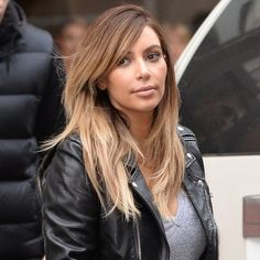 kim kardashian blonde hair - leather jacket and grey tshirt - kim kardahsian ombre hair colour - handbag.com
